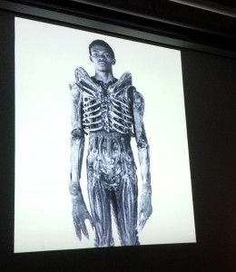 Bolaji Badejo in an Alien suit