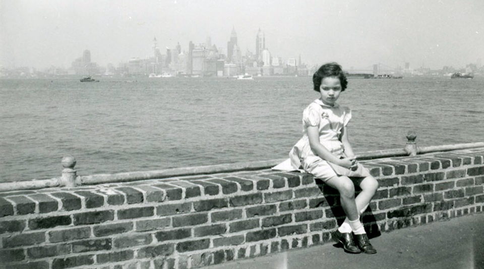 Vivian Maier, (Girl Seated on Brick Wall). Image courtesy Stephen Bulger Gallery © Vivian Maier