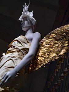 "Mugler. Ensemble, autumn/winter 1984–85. Ivory silk taffeta and gold-painted feathers. ""Heavenly Bodies: Fashion and the Catholic Imagination"". ©Kristina Nazarevskaia for galleryIntell"